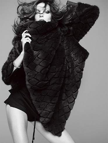 Daria Werbowy with a fur vest in hand for V magazine