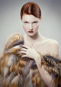 Woman with brown grey fur vest