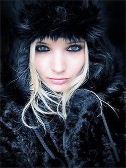 Blode girl with fur vest