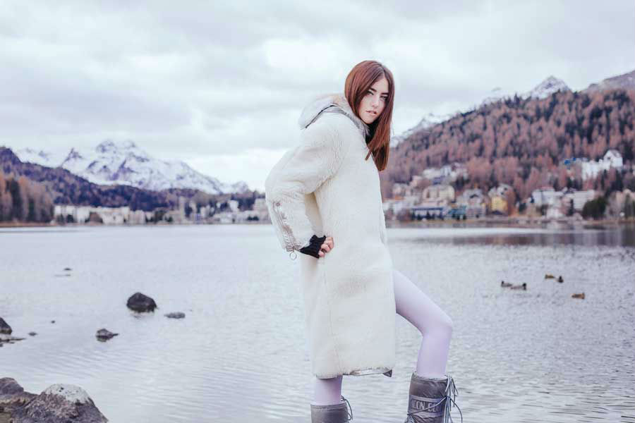 st moritz lady fur wearing white fur coat