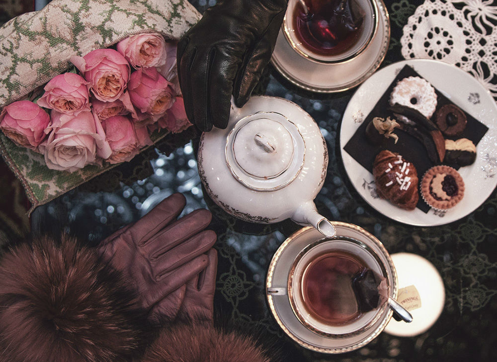 premiato forno table with tea and fur leather gloves