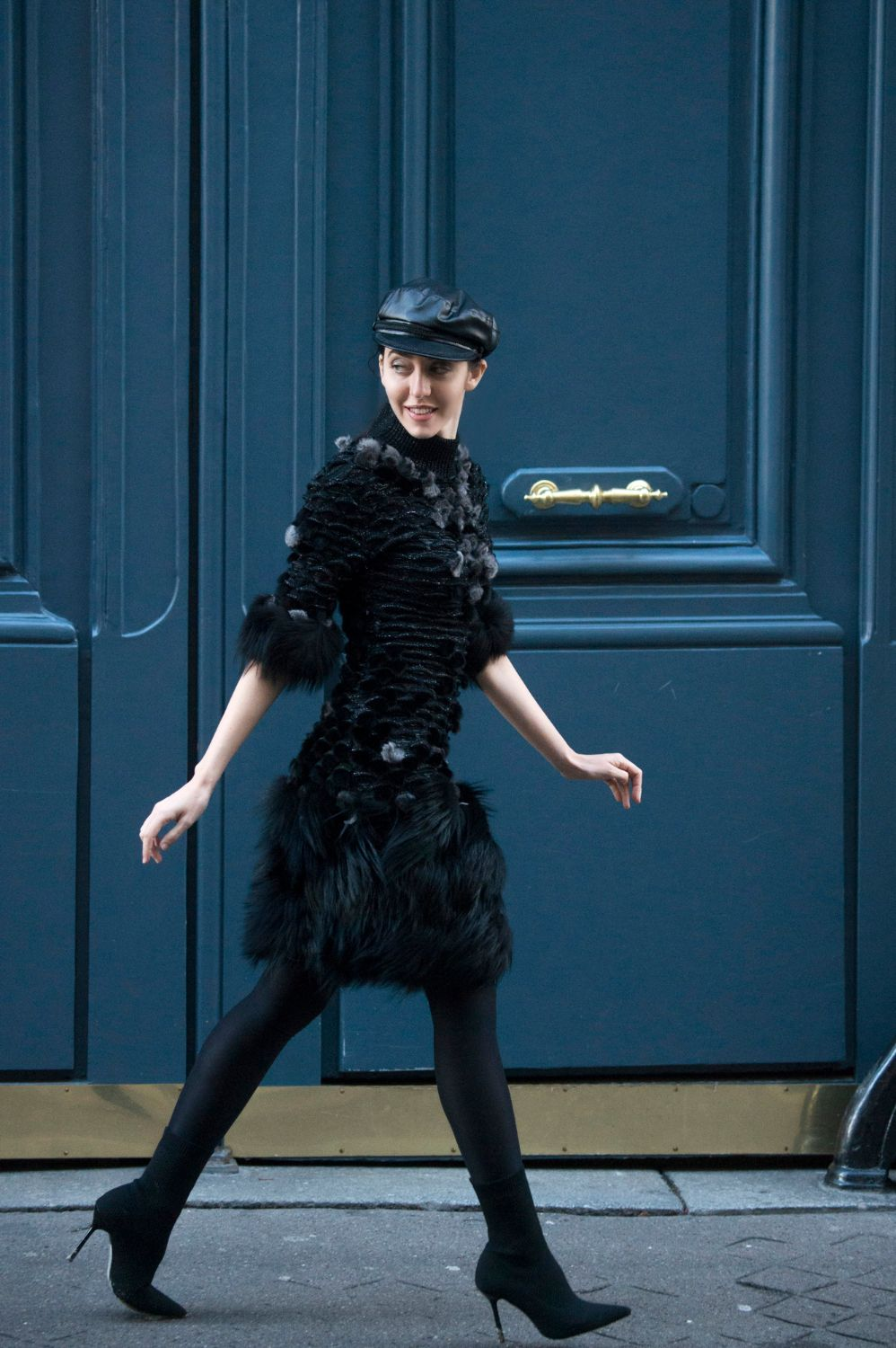 Lady Fur running to Dior show with the fur dress