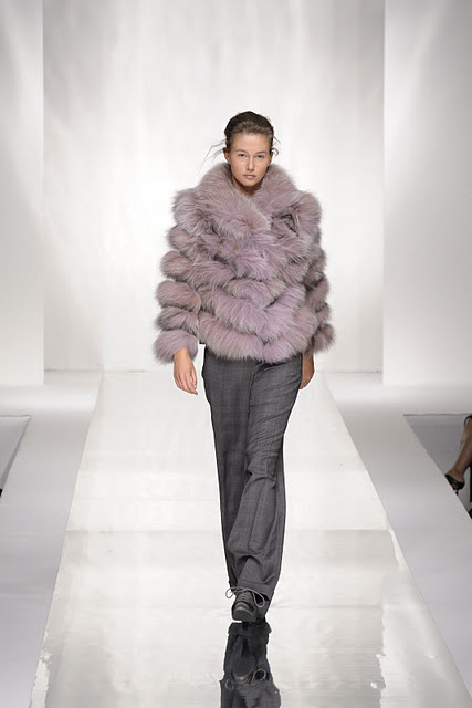 Model wearing fur coat at Carlo Ramello Fashion Show