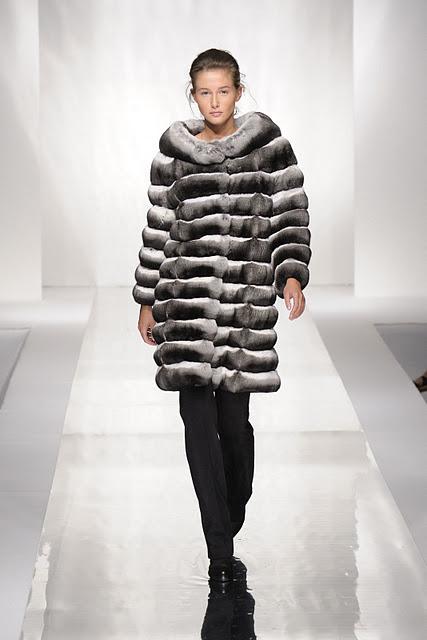 Woman wearing Carlo Ramello black white grey coat