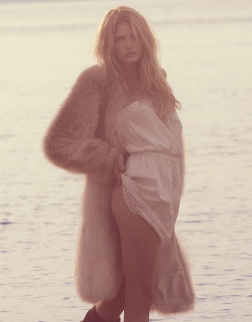 Top model Lily Donaldson wearing fur near the sea