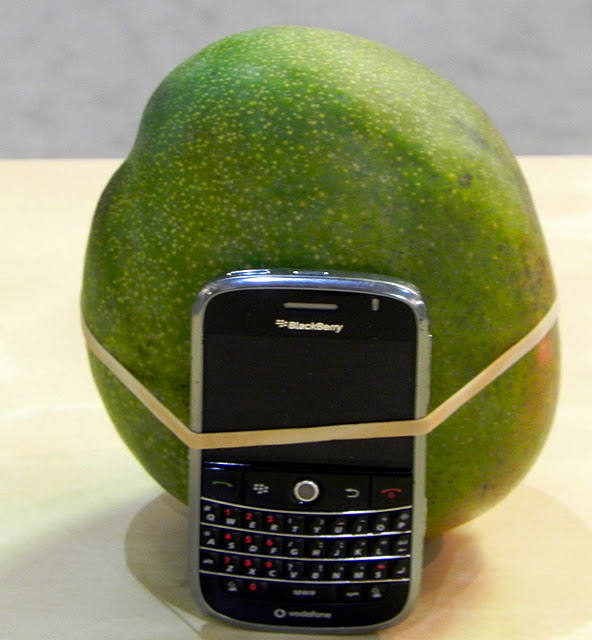 artissima art with cellphone and fruit