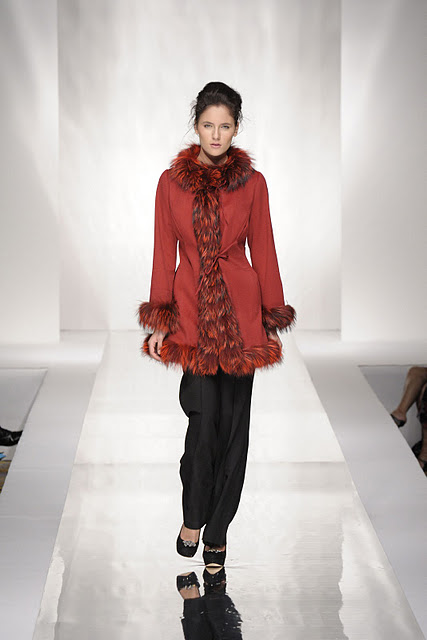 Woman with red fur vest