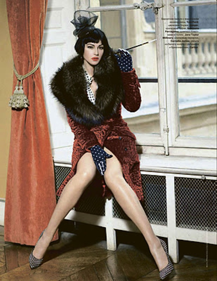 Monica Bellucci wearing red and black fur vest