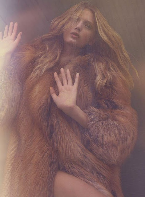 Lily Donaldson brown fur coat at the window
