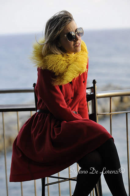 Lady Fur with a yellow and red fur vest