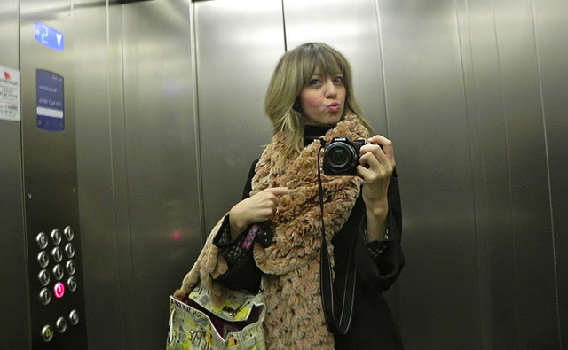Lady fur taking photo with fur coat inside elevator