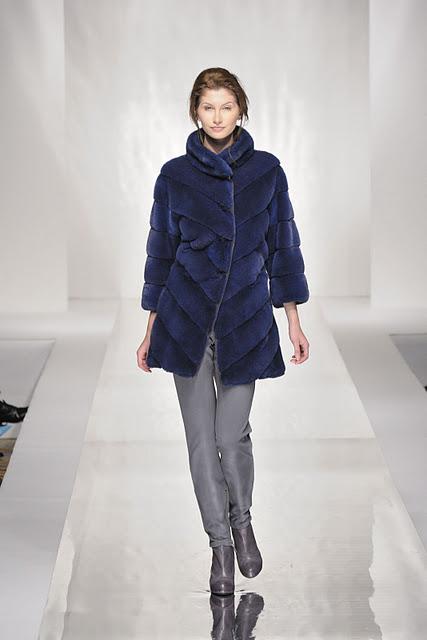 Blue fur vest on model in Carlo Ramello Fashion Show