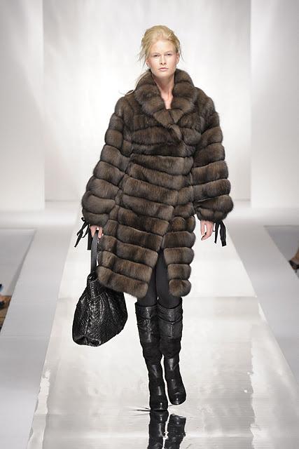 Woman wearing long brown fur coat