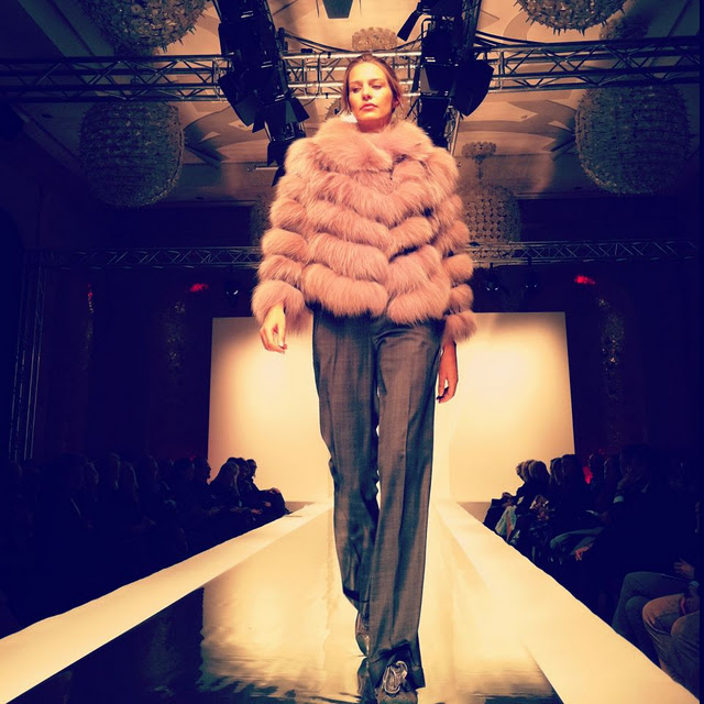 Woman wearing fur coat in Carlo Ramello show