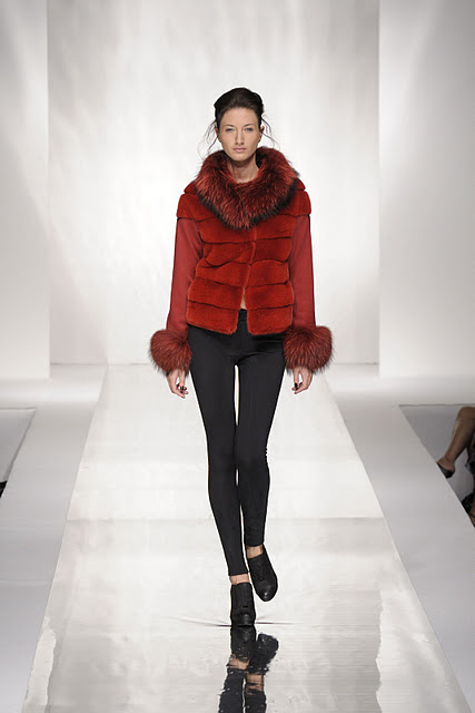 woman with carlo ramello red fur coat