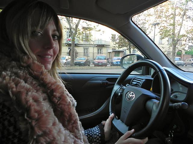 lady fur back inside her car
