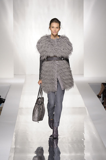 Woman wearing grey fur fashion coat