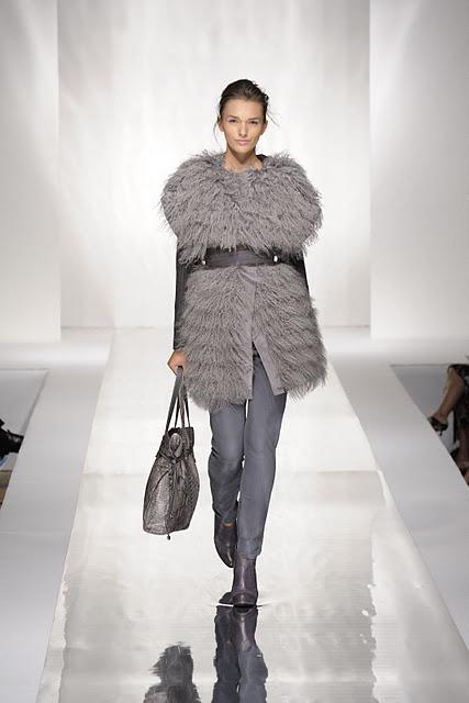 Woman wearing grey fur fashion coat
