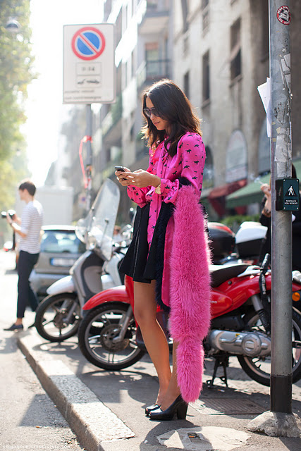 lady with pink fur vest milano